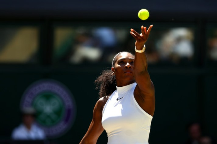 Serena Williams of The United States serves during the Ladies Singles Semi Final match against Elena Vesnina of Russia on day ten of the Wimbledon Lawn Tennis Championships at the All England Lawn Tennis and Croquet Club on July 7, 2016 in London, England.