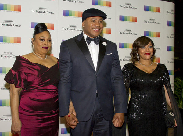 LL Cool J, center, arrives with his Mother, Andrea Smith, left and his wife, Simone Smith, right, for the formal Artist's Dinner honoring the recipients of the 40th Annual Kennedy Center Honors hosted by United States Secretary of State Rex Tillerson at the US Department of State on December 2, 2017 in Washington, DC.