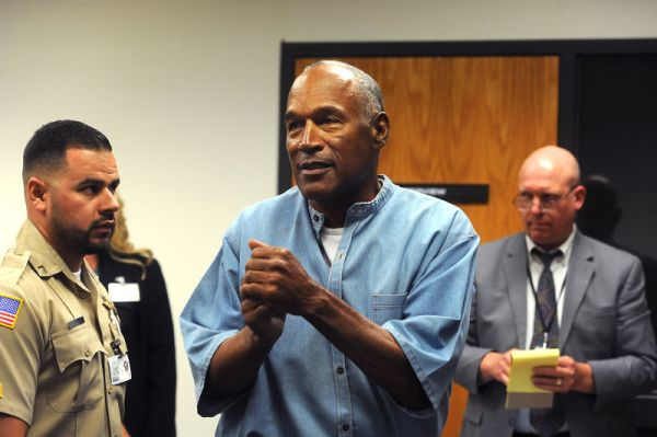 O.J. Simpson reacts after learning he was granted parole at Lovelock Correctional Center on July 20, 2017, in Lovelock, Nev. Photo: Jason Bean-Pool (Getty Images)