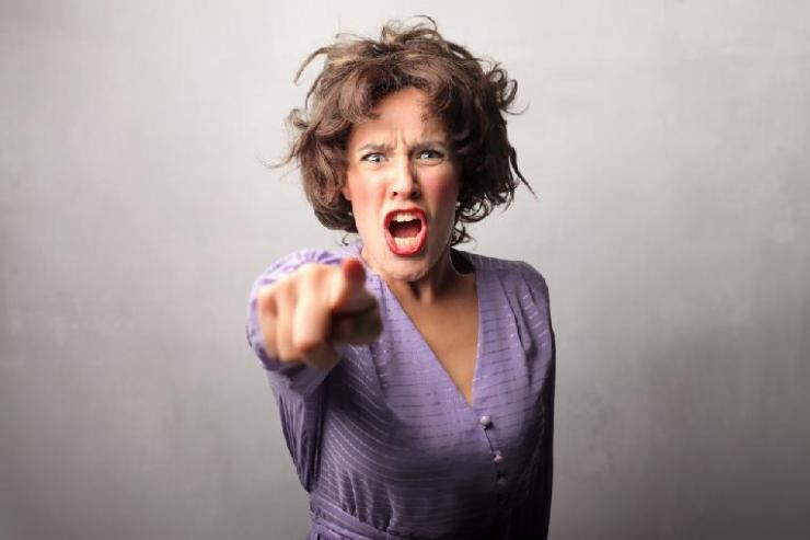 woman pointing finger (accusing)