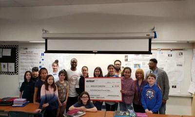Baron Jay with kids and Verizon donation