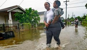 woman with child - tropical storm barry