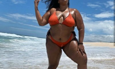 lizzo in red swim suit