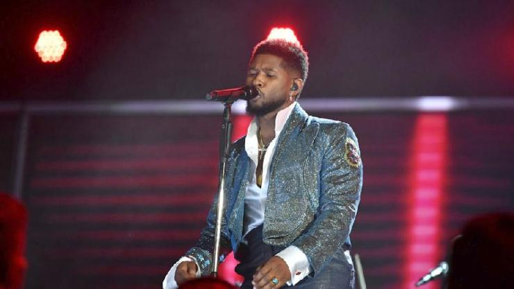 Usher performing - Getty