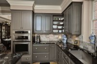 grey-kitchen-cabinets-with-patterned-black-granite-countertop