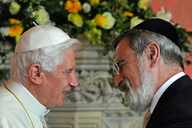 """Pope Benedict XVI (L), meets Britain's Chief Rabbi Jonathan Sacks, during a meeting of religious leaders at St Mary's University College, in Twickenham, south-west London on September 17, 2010. British police arrested five men Friday on suspicion of plotting a """"terrorist"""" attack linked to the historic state visit of Pope Benedict XVI. The Vatican insisted that the pope was """"calm"""" following the arrests and that it had full confidence in Scotland Yard's ability to protect him."""