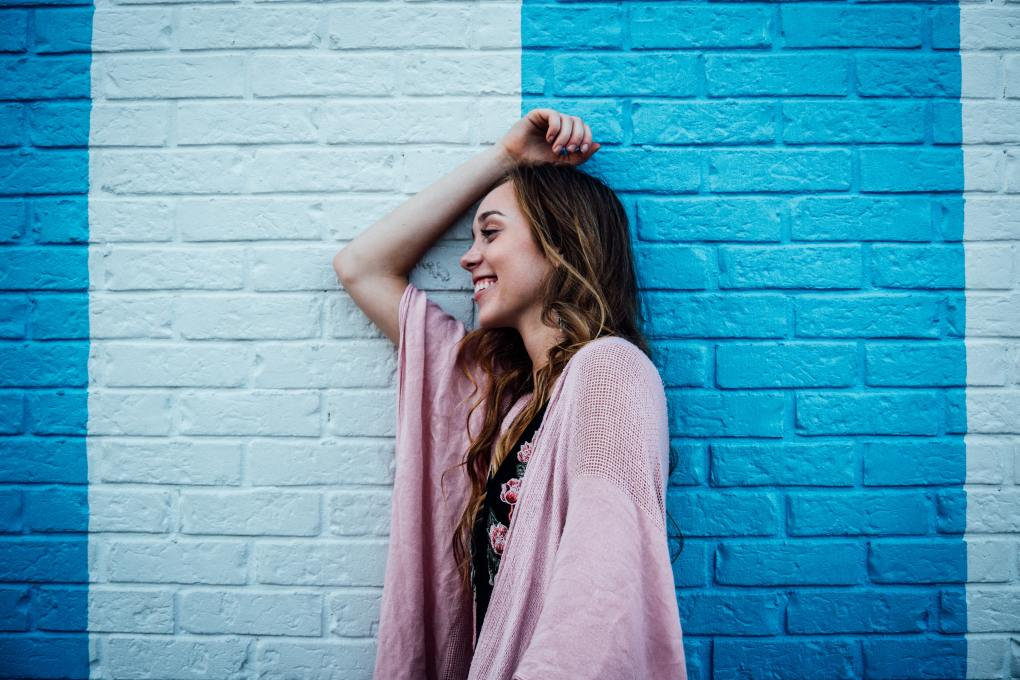 happy woman smiling between two colours