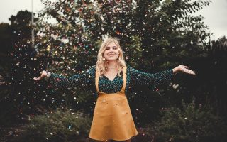 woman in confetti rain how to become a money magnet