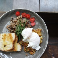 Poasched eggs on hash, with mushrooms and toast