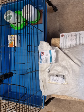 chicken brooder on stand with chicken feed
