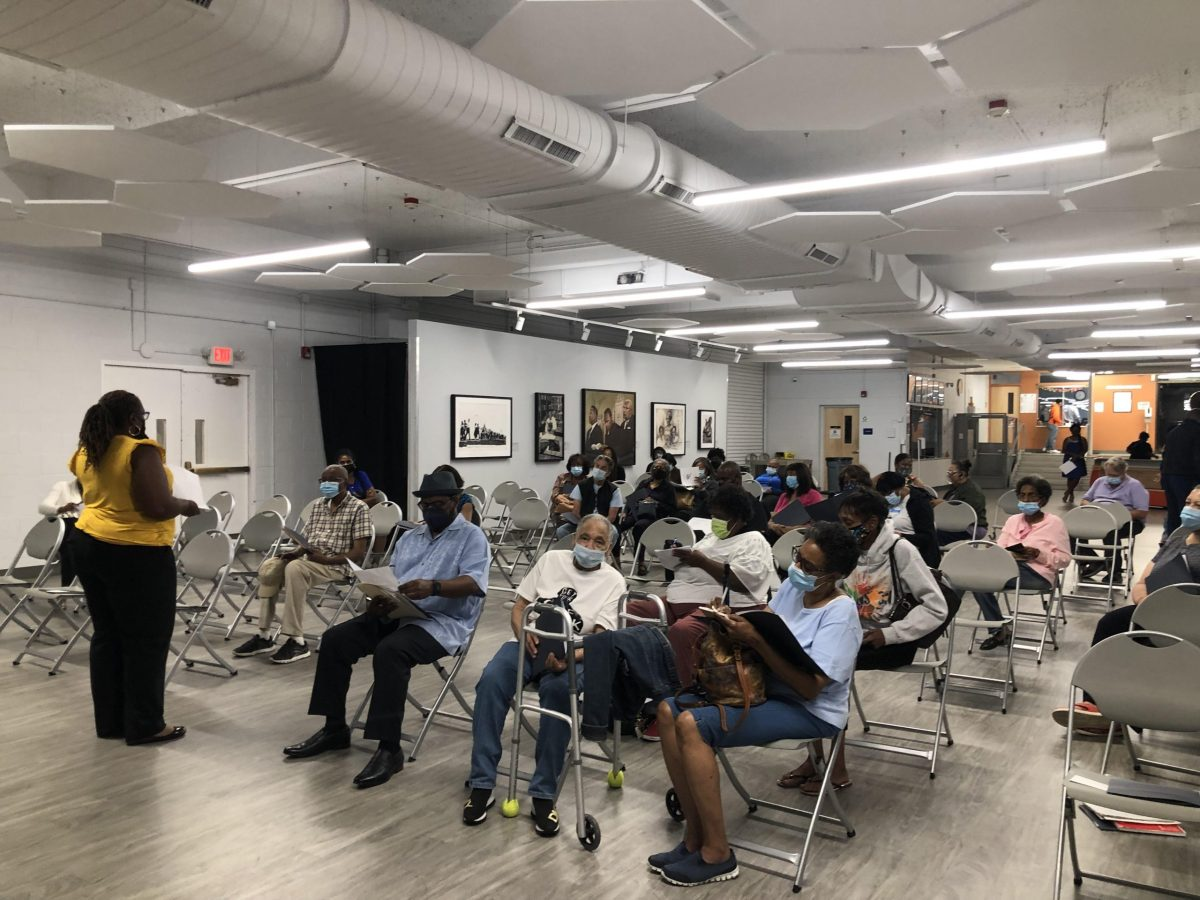 Deputy to the City Manager Kimberly Richardson addresses a crowd of 40 at the Fleetwood-Jourdain Center during the third informational session on the restorative housing program.
