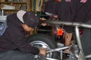 New Energy Academy high school students working on the Switch EV