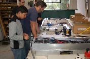 High School students assembling an EV dashboard