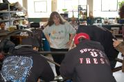 Electric Auto Shop teacher overseeing assembly of a ChassisLab electric car course.