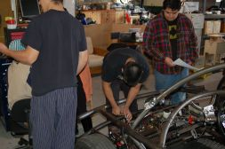 Students installing batteries in an electric car.