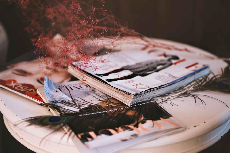three magazine on table