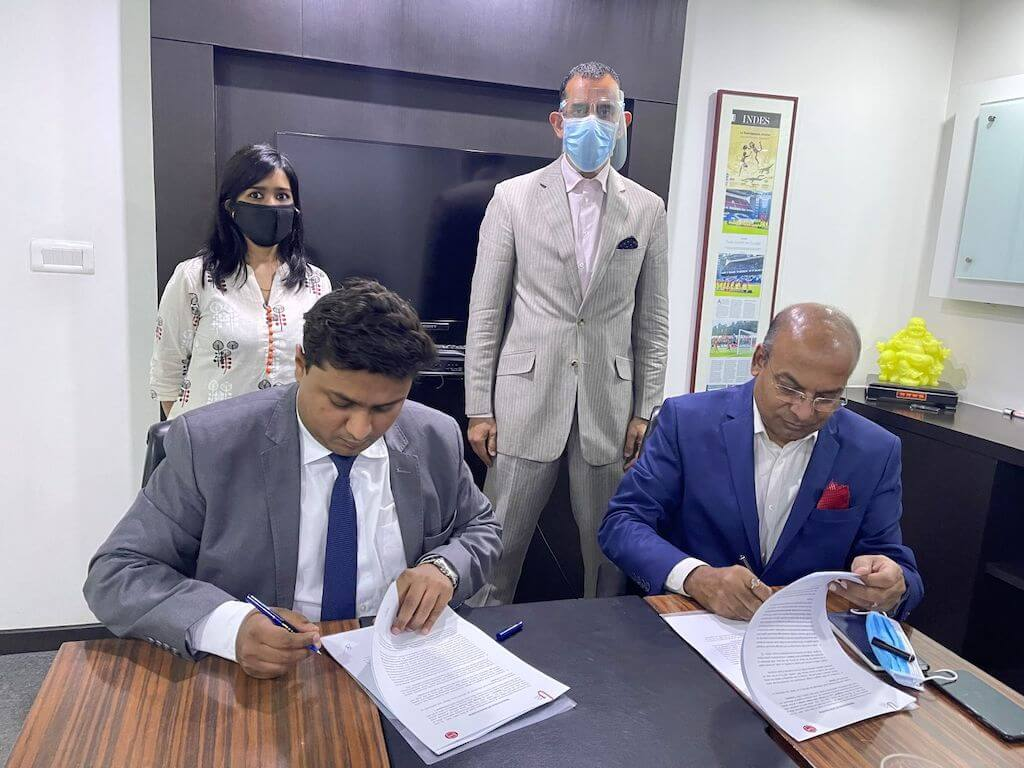 Dr. Deb Mukherji, Managing Director, Omega Seiki Mobility signs MoU With Mr. Kuldeep Gupta, Vice President Strategic Partnership, C4V USA