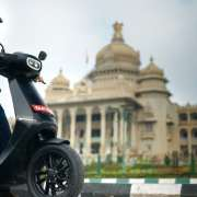 Ola Electric Bhavish Aggarwal on Ola Scooter in front of Vidhana Soudha