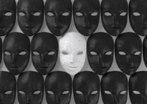 Smiling white mask among black masks, Hypocritical concept, 3d rendering