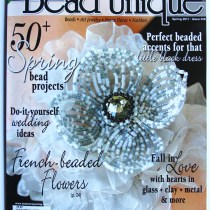 French beaded flower made with white and gray beads
