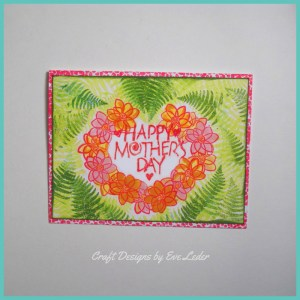 Card Making Masking Technique introduction. Learn about this technique used to create a Mother's day card. It has a heart shaped wreath made of flowers.