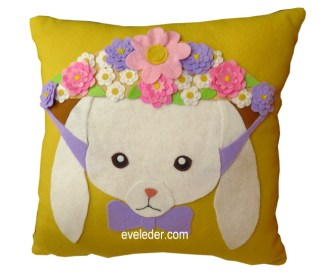 Rabbit Pillow--Free pattern and tutorial to make this pillow featuring a rabbit wearing a bonnet