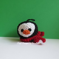Amigurumi Penguin Ornament--FREE crochet pattern for a penguin Christmas ornament. This adorable penguin is wearing a festive red scarf.