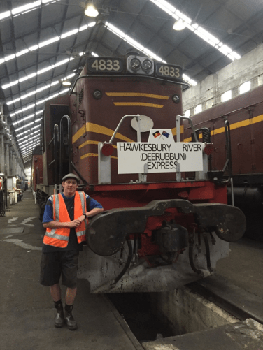 Bungoree's direct descendant Brett Rowling poses with the train's new headboard, highlighting the Indigenous cultural connection.
