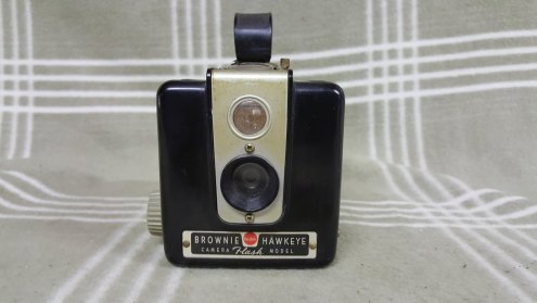 Kodak Brownie Hawkeye as shipped viewed from the front. Note the stains near the lens assemblies.