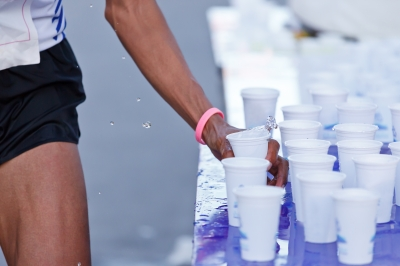marathon-racer-catching-cup-water