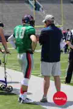 Chad Kelly listens to Coach