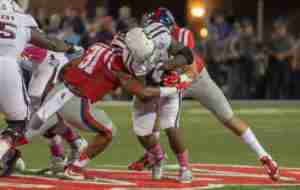 DeMarquis Gates makes a tackle during the win over A&M this season. (Photo credit; Bentley Breland, The Rebel Walk)