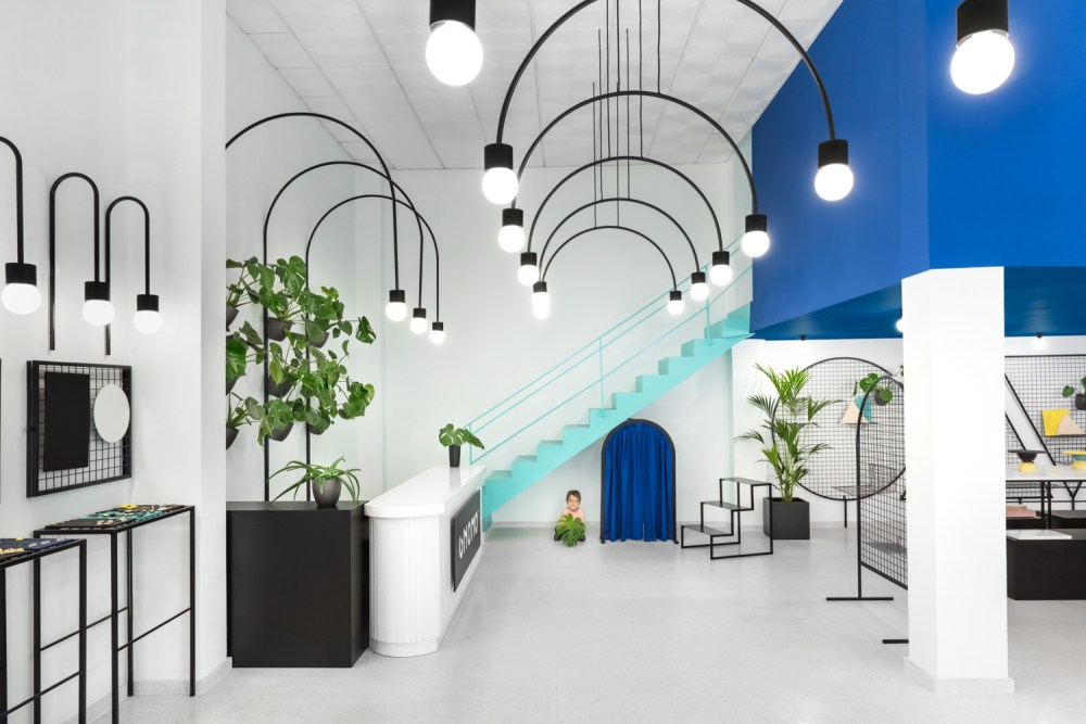 Masquespacio's interior design project for Gnomo mixes bold geometry, graphical elements and fun colours to create a quirky, modern feel.  Gnomo offer everything you need for your contemporary survival: from a ring to a shelf, to house plants. They sell a diverse, eclectic collection of products with a distinct retro vibe. Masquespacio wanted to capture the 80's eclectic feel within the interior and exterior of the store.