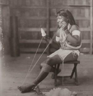 An Aboriginal Indian Woman spinning cotton