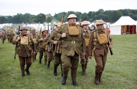 KELMARSH, UNITED KINGDOM - JULY 20: Re-enactors take part in the 'History Live!' event at Kelmarsh Hall in Northamptonshire on July 20, 2013 in Kelmarsh, England. The English Heritage event 'History Live!' brings together over 2000 re-enactors to animate 2000 years of English history. The re-enactment highlights include: the Battle of Hastings, Wars of the Roses, Roman soldiers and the D-Day landings. (Photo by Oli Scarff/Getty Images)