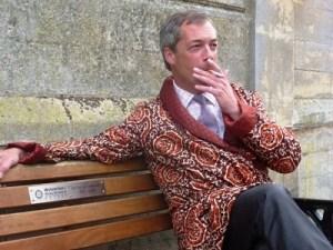 Farage enjoys a ciggie after polishing his gun