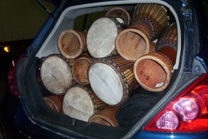 Twenty-odd djembes in one small car!