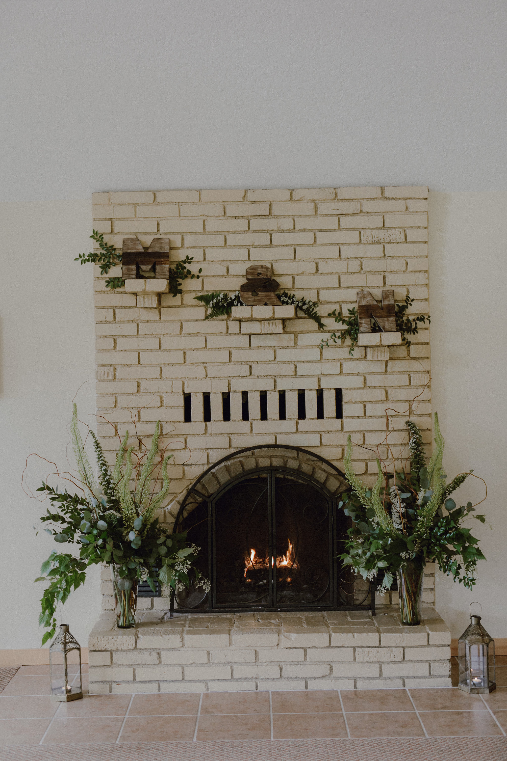 Passionflower Design in Eugene provided all of the flowers and greenery for the wedding, and they left me with a big bucket of extras so I had fun adding extra greenery to the cake table and the fireplace!