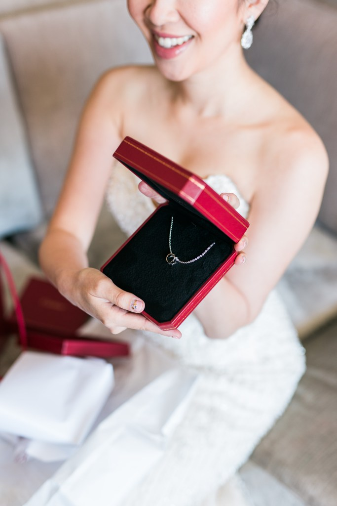 Bride presenting a necklace. How to support local austin businesses for Christmas