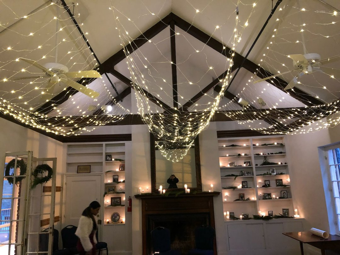 Small wedding venue decorated with string lighting for a ceremony