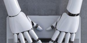 A robot's hand touching a computer
