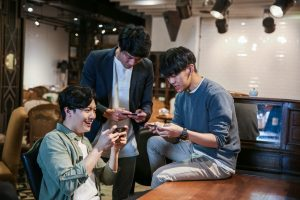 Group of people playing mobile games together