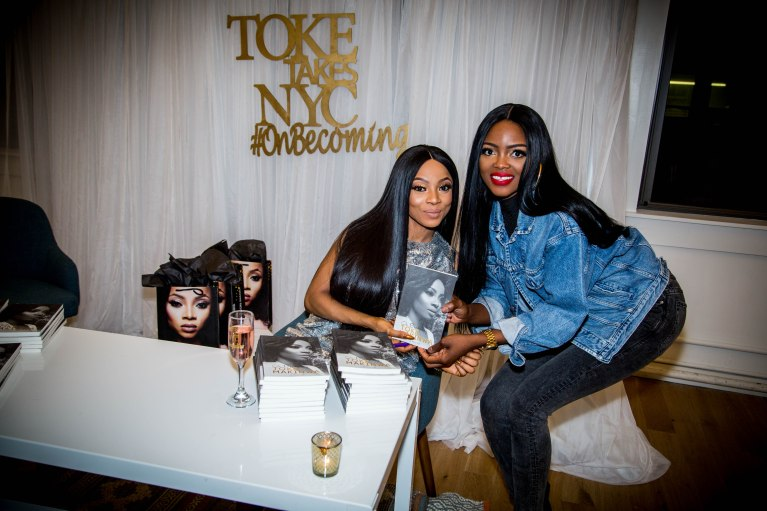 Toke Makinwa with a fan at the New York Book Tour Stop