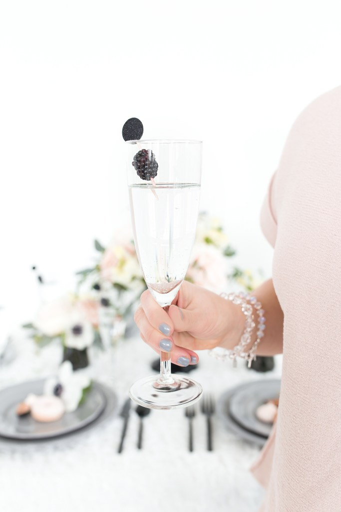 annapolis maryland intimate micro wedding, blush and grey woman holding champagne