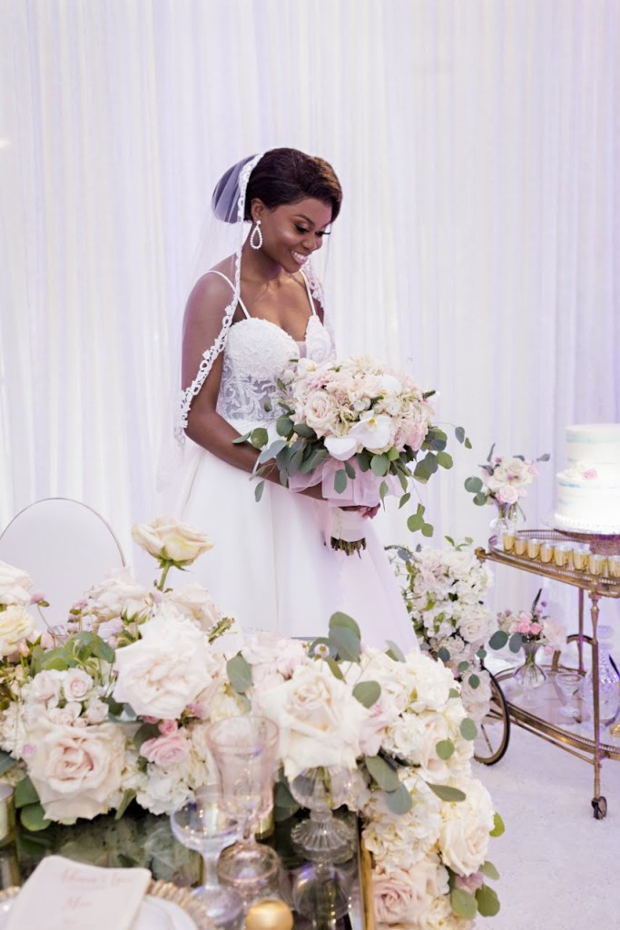 nigerian bride lush blush tablescape with gold and light pink florals and candles
