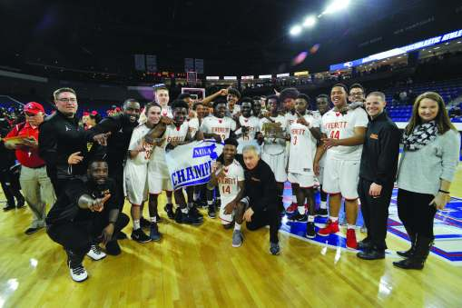 The Everett High School basketball team celebrwates its victory over Lawrence in Saturday's Div. 1 North Final at the Tsongas Center. The sectional crown is the Crimson Tide's first since 1994.