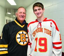 Former Bruins goaltender Reggie Lemelin is pictured with Everett High senior Jason Cardinale