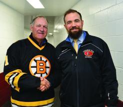 Former Bruins goaltender Reggie Lemelin is pictured with Crimson Tide head coach Erick Kainen.