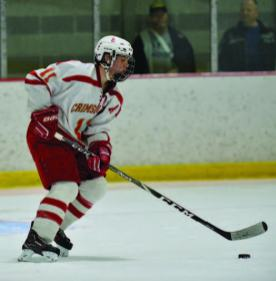 Senior defenseman Nathan Johnson handles the puck