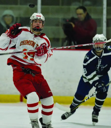 Senior Jason Cardinale keeps his eyes on a rising puck.